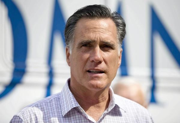 Mitt Romney, seen here at a campaign stop in New Hampshire, has received sharp criticism for his comments belittling President Obama's supporters.