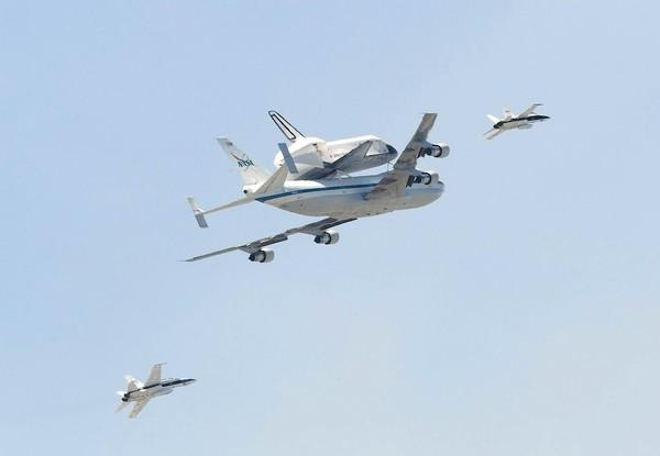 The space shuttle Endeavour flies over the Orange County coastline on its way to Los Angeles International Airport on Friday.