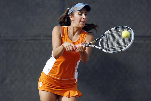 Pasadena Poly's Alyssa Boghosian hits the ball during a match against Flintridge Prep at Scholl Canyon Tennis Center in Glendale on Friday, September 21, 2012.