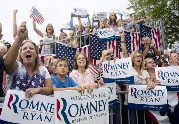 Supporters cheer for Mitt Romney and Paul Ryan in Waukesha, Wis. In a poll, 53% of state voters said that Romney doesn't care about people like them.