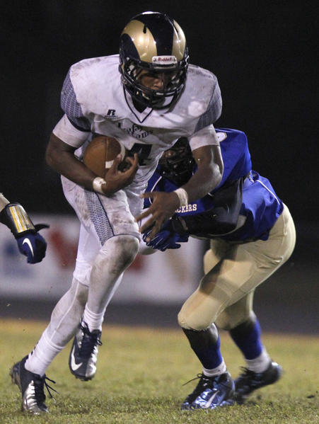Lafayette's Jahlil Green finds an opening to carry the ball during the second half of Friday's game against Smithfield.
