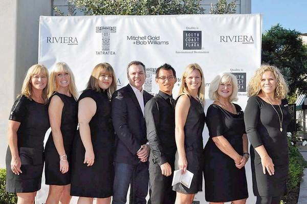 Bob Williams, center, with his staff at reception in Costa Mesa greeting 400 guests showcasing fall home design.