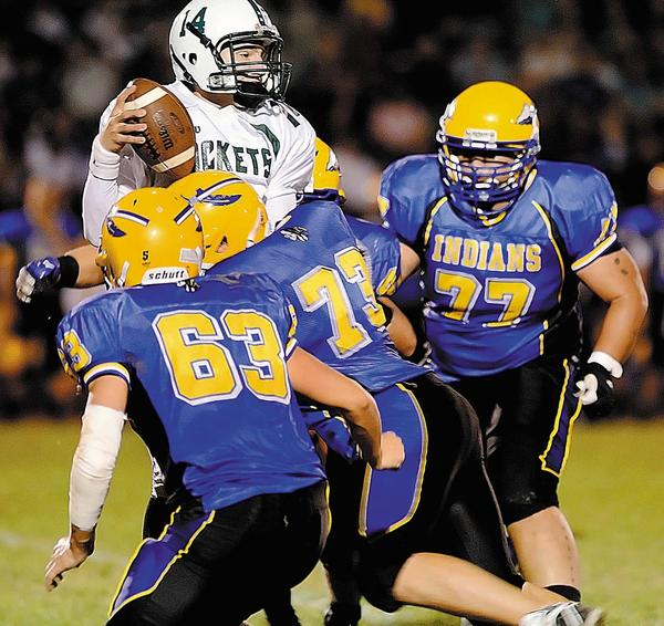 Waynesboro's Matt Bricker (63), Andrew Paterno (73) and Karem Taylor (77) close in to sack James Buchanan quarterback Caleb Martin on Friday during the second quarter of the Indians' 48-20 win.