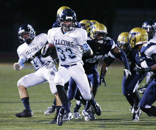 Crescenta Valley's Chad Eggertson runs the ball back during a punt return against Muir in the first quarter in a Pacific League football game at Muir High School in Pasadena on Friday, Setember 21, 2012.