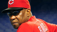 Cincinnati Reds manager Dusty Baker was still in a Chicago hospital Saturday but is likely to return to the dugout Sunday.
