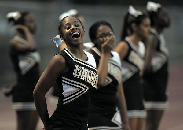 Everglades cheerleaders watch their team play Western.