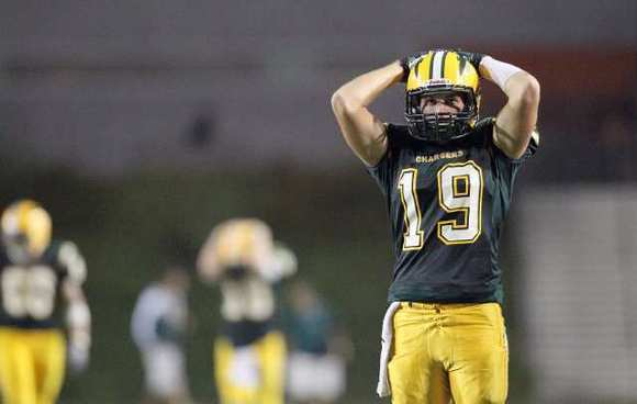 Edison's Marcus Stepancich reacts after losing to Mater Dei 20-14 at Orange Coast College on Friday.