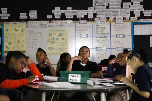 Courtney Hicks, 11, center, contemplates a problem in a fouth- and fifth-grade math class at National Teachers Academy, 55 W. Cermak Road, a Academy for Urban School Leadership turnaround school.