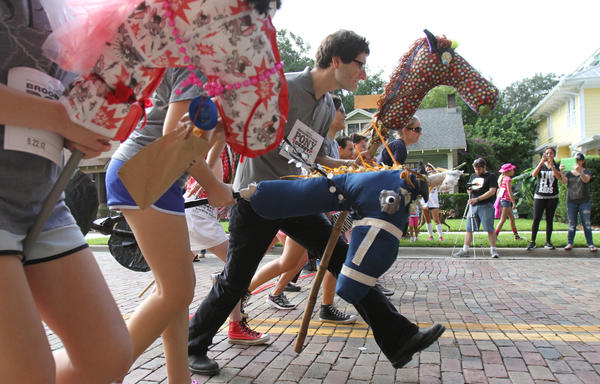 Contestants take part in Urban ReThink's Broomstick Pony Derby in the Thornton Park neighborhood of Orlando, Fla.