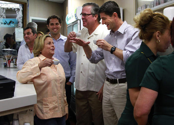 Republican Vice Presidential candidate Paul Ryan drinks Cuban Coffee in Miami during his Victory Rally at Versailles Restaurant with (L to R) Ileana Ros-Lehtinen, Craig Romney, and Jeb Bush.