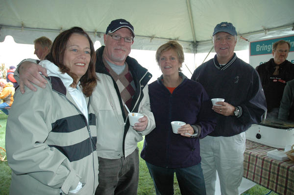 Laura Burke, Dick Burke, Carol Anderson and John Anderson, all of Petoskey, sample chili from the Harbor Springs IGA.