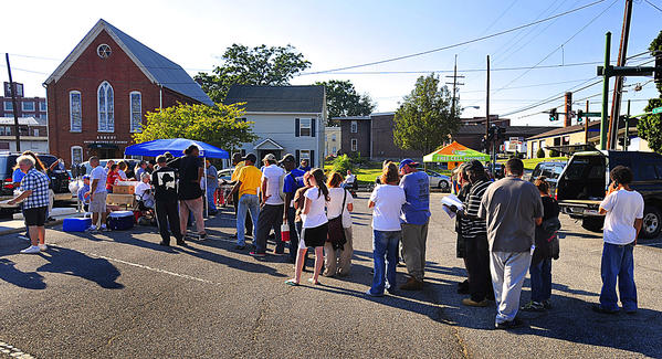 People wait in line Wednesday September 12 at Soul Food event at Market Lot in Hagerstown.