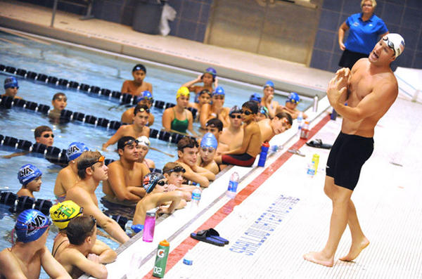 2012 Olympic swimming gold medal winner Brendan Hansen of Havertown gives a clinic to members of Lehigh Valley Aquatics at Liberty High School's pool Saturday.
