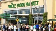 A Whole Foods Market grocery opened its doors Wednesday morning at Fashion Island, drawing hundreds of customers who lined up for a chance to be among the first to explore the 32,000-square-foot shop.