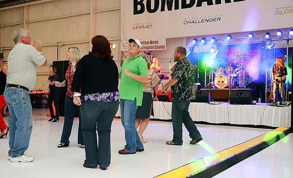 "People dance to the music of ""The Reagan Years"" at HangarFest held at Rider Jet Center Saturday night."