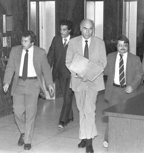 """I can't think of one thing I did that I have any guilt about,"" Edwin Wilson, second from right, shown leaving court in Houston in 1983, said in 2006. ""I didn't hurt anybody. I didn't get anyone killed."""