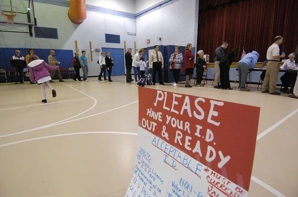 A handmade sign advises voters to have an ID handy, at Kratzer Elementary School in South Whitehall Township, Nov.2, 2004.