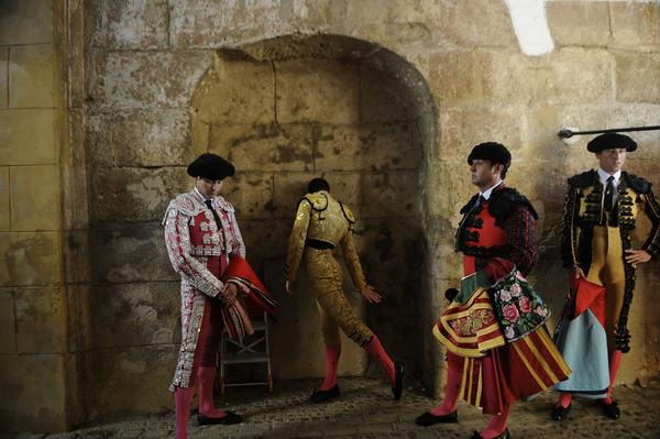 "Spanish matador Manuel Jesus ""Daniel Luque"" (2nd-L) prepares before a bullfight at the Maestranza Bullring in Sevilla, on September 22, 2012."