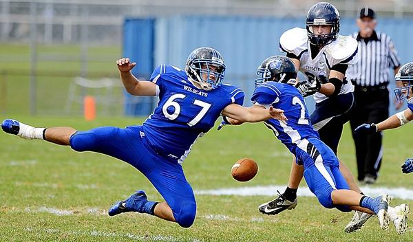 Williamsport's Josh Miller (67) and Nick Berchock break up a pass intended for Catoctin's Mark Speak in the second quarter of Saturday's MVAL Antietam football game in Williamsport.