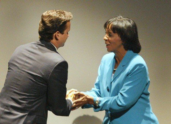 Deputy Dist. Atty. Alan Jackson, left, and Chief Deputy Dist. Atty. Jackie Lacey shake hands after a debate in August. They are running to replace Dist. Atty. Steve Cooley.