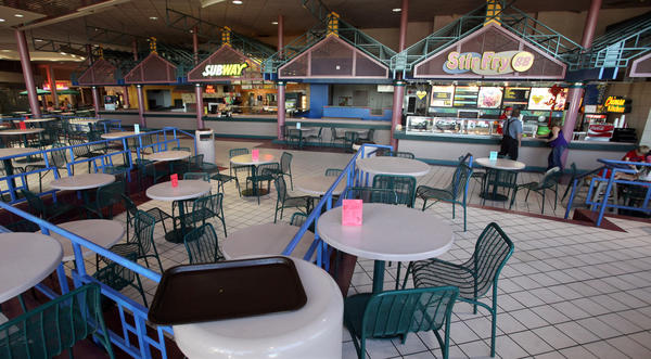 The food court area at Lakewood Mall is more empty than full. The most recent departure from the mall was Taco John's, which had a presence at the mall for 21 years.