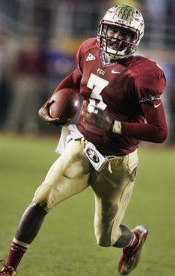 FSU quarterback E.J. Manuel smiles as he scrambles for a first down with seconds left on the clock during the Clemson at Florida State University football game at Doak Campbell Stadium in Tallahassee on Saturday, September 22, 2012. FSU won the game 49-37.