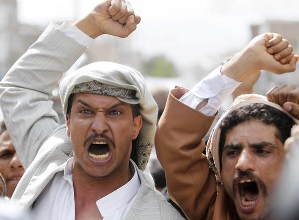 Protesters gatherl ast week on a road leading to the U.S. embassy in Sanaa, Yemen.
