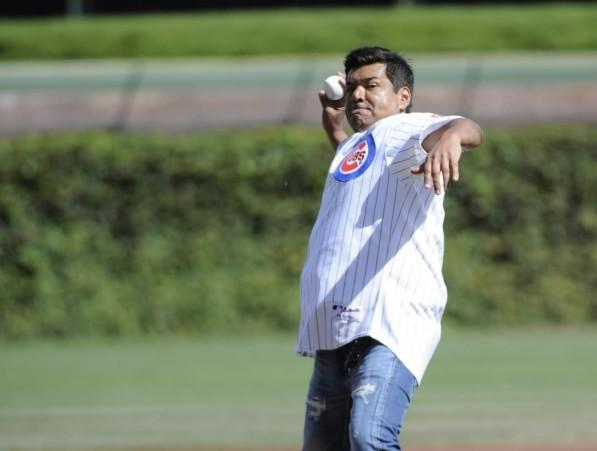 Comedian George Lopez throws out the first pitch before the Cubs-St. Louis Cardinals game September 22, 2012 at Wrigley Field.
