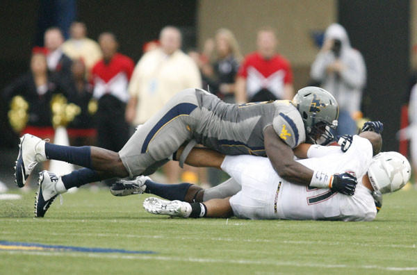 Terps QB Perry Hills is sacked by West Virginia's Will Clarke.