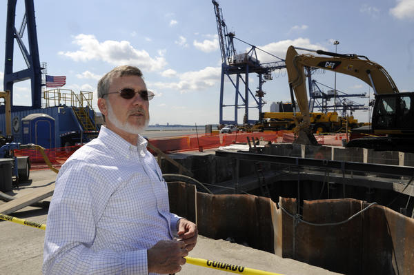 John Morris, director of remediation for Honeywell International Inc., stands in front of a filtering installation at Dundalk Marine Terminal.