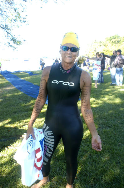Susan Spencer, 61, a lawyer from Baltimore who swam three miles, listed 25 friends and relatives who died from cancer on her right arm; on her left are the names of 14 people who survived cancer or are in remission.
