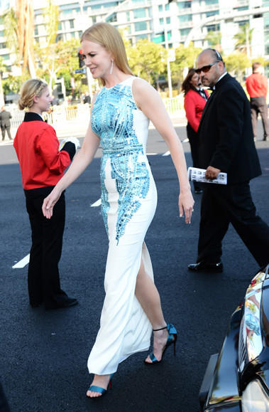 Nicole Kidman arrives at the 2012 Emmys wearing a white column gown with scale-like embroidery by Antonio Berardi.
