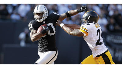Oakland Raiders wide receiver Derek Hagan runs against the Pittsburgh Steelers on Sunday.