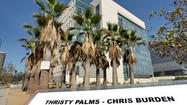 Four straight rows of four palm trees each stand on the northeast corner of 2nd and Spring streets downtown — a block from Los Angeles City Hall, right alongside LAPD headquarters.