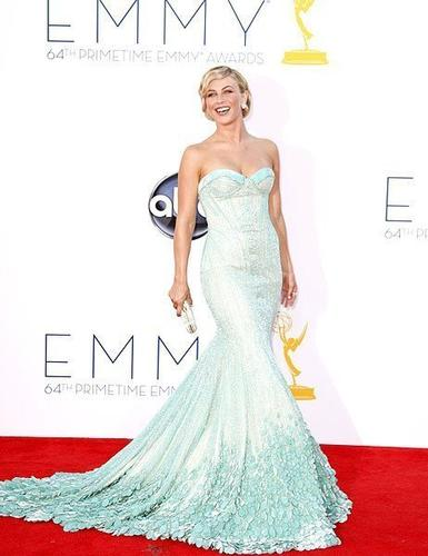 """Actress and dancer Julianne Hough <style type=""""text/css"""">                 /* Main div */                 div.ent-must-reads {                                 width: 615px;                 margin-top: 20px;                 height: auto;                 }                  /* Picks */                 div.ent-pick {                                 float: left;                                 margin: 0px auto;                                 width: 206px;                 }            div.ent-pick img{                 margin:3px 7px 2px 0px;                 height: 105px;                 width:187px;                 display: inline-block;                 float: left;        }                  div.ent-pick a img {                                 border: none;                 }                  div.ent-pick a {                                 margin: 3px;                 }  /* Headers */ div.content h2#title {                 font-size:16px;                                 font-weight: bold;                                 margin-bottom: 4px;                 }  div.content  p#ent-hed{ font-size: 13px; margin: 6px; width: 192px; }  </style>   <div class=""""ent-must-reads"""">  <!-- Title of your runtime --> <h2 id=""""title"""">MORE ON THE 2012 EMMYS:</h2>  <!-- 1 --> <div class=""""ent-pick""""> <!-- Image and image link--> <a href=""""http://www.latimes.com/entertainment/envelope/emmys/la-et-st-emmys-2012-red-carpet-dresses-arrivals-pictures,0,4667375.photogallery"""" target=""""_top""""> <img src=""""http://www.trbimg.com/img-505f8f1d/turbine/la-et-st-emmys-2012-red-carpet-dresses-arrivals-pictures/187/16x9"""" alt="""""""" /> </a>         <!-- Headline and headline link --> <a href=""""http://www.latimes.com/entertainment/envelope/emmys/la-et-st-emmys-2012-red-carpet-dresses-arrivals-pictures,0,4667375.photogallery"""" target=""""_top""""> <p id=""""ent-hed"""">Photos: Red carpet arrivals</p> </a>     </div>   <!-- 2 -->  <div class=""""ent-pick""""> <!-- Image and image link--> <a href=""""http://www.latimes.com/entertainment/envelope/e"""