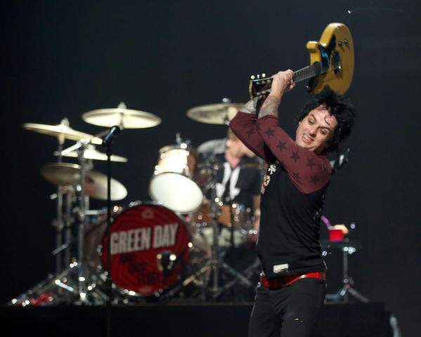 Green Day's Billie Joe Armstrong smashes his guitar at the iHeartRadio Festival in Las Vegas.