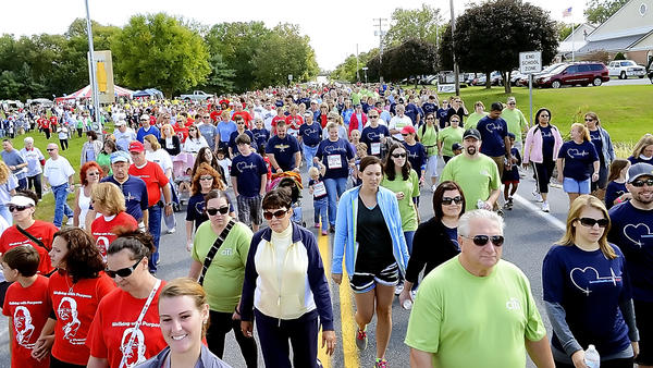 Participants in the 2012 Mason Dixon Heart and Stroke Walk fill Leitersburg Street in Greencastle, Pa., Sunday during the event.