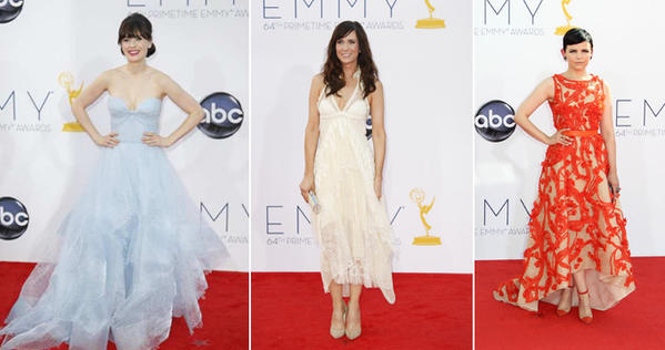 Zooey Deschanel, left, wears a Grace Kelly-ish, icy blue tulle sweetheart neckline gown by Reem Acra. Kristen Wiig, center, in a white chiffon slip dress from Balenciaga. Ginnifer Goodwin is in a Monique Lhuillier dress.