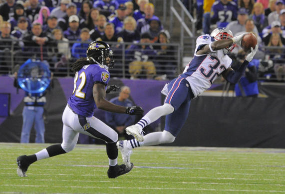 Patriots cornerback Devin McCourty stretches in front of Torrey Smith but can't come up with the INT.
