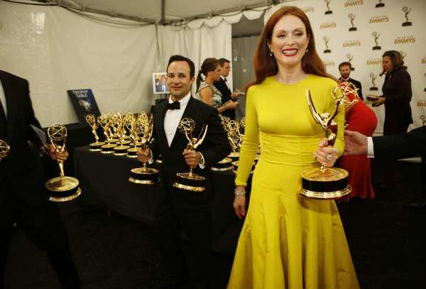 Julianne Moore's vivid yellow, long-sleeve, knitted cashmere top and silk ball skirt from Raf Simons' first couture collection for Christian Dior shown in Paris in July was an insidery fashion choice to be sure, and a modern take on dressing up. But the color and silhouette didn't particularly flatter her.