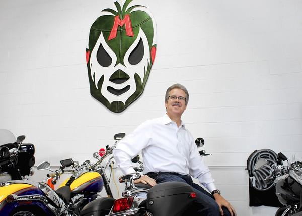 "Roberto Herencia, CEO of BXM Holdings Inc., keeps his Harleys in his ""man cave,"" which is a storage unit in Glenview that also has a couch and a 6-foot lucha libre mask."
