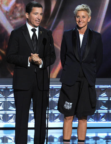 Academy of Television Arts and Sciences Chairman and CEO Bruce Rosenblum, left, takes the stage with a pantless Ellen DeGeneres. DeGeneres gave her pants to Emmy host Jimmy Kimmel in the show's opening sequence.