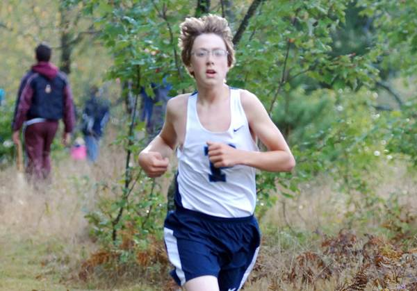 Max Meyerson of Petoskey runs to an eighth-place finish in the boys 9th-10th grade race Saturday during the 38th Annual Petoskey Cross Country Invitational at Camp Pet-O-Se-Ga.