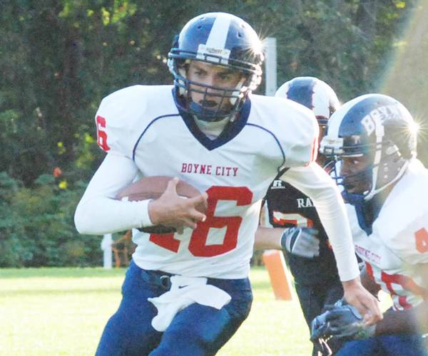 Boyne City quarterback Corey Redman threw two touchdown passes, ran for a TD and made an interception in the fourth quarter Saturday, leading the Ramblers to a 29-13 victory over Traverse City St. Francis.