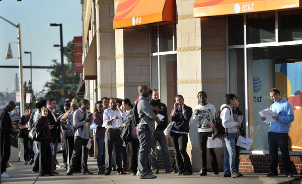 People line up outside the AT&T store in the 1000 block of Fleet Street to buy the iPhone 5 on the first day of sales.