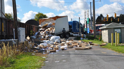 A train hit a tractor trailer Monday morning near the feed mill.