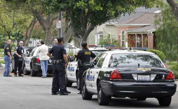 Burbank Police finish up at the scene of a shooting on the 400 block of South Lamer St. on Thursday, July 12, 2012.