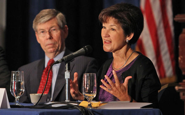 Alex Sink, right, and Bill McCollum participate on a panel at the Orlando Sentinel's Florida Forum on Monday in downtown Orlando.