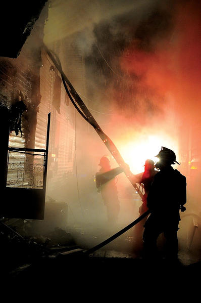 Winchester Fire-EMS firefighters battle a blaze around 4:30 a.m. Sunday that heavily damaged the back of a home at 48 1/2 Smith Ave. The two-alarm fire caused heat, smoke and fire damage to the entire structure.