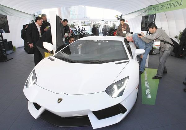 A  Lamborghini Aventador LP700-4 attracts attention from showgoers during the 2012 International Consumer Electronics Show in Las Vegas.